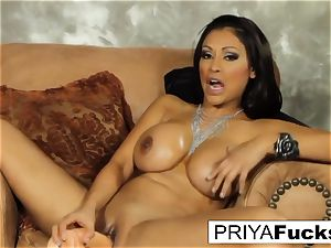 Priya sates her thirst with a plaything