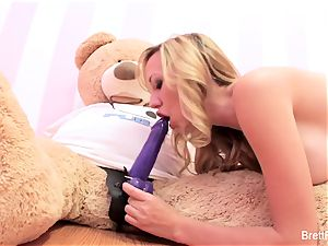 Brett Rossi plays with a tucked bear's strap-on dildo