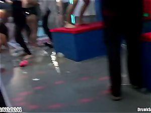 Mass pornography romp in a striptease bar
