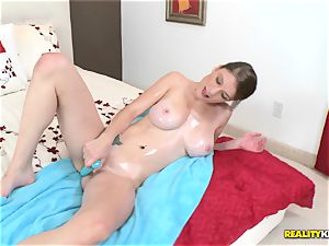 ample titted Dillion Carter jerks on camera