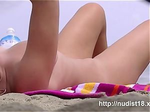 warm women get nude on the beach for the spy webcam