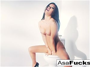 Asa Akira uses a faux arm to please her beaver