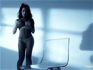big-titted dark-haired Capri Cavanni works her moist cunny
