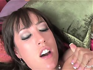 huge-boobed Capri Cavanni pummels on the couch
